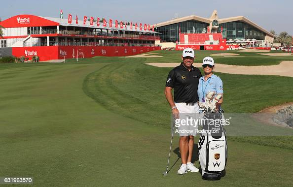 Lee Westwood of England is pictured with his girlfriend Helen Storey acting as his caddie during the Pro Am event prior to the start of the Abu Dhabi...