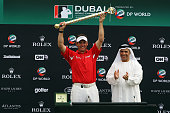 Lee Westwood of England is presented with the Dubai World Championship Trophy by His Excellency Matar al Tayer Vice President of the Dubai Sports...