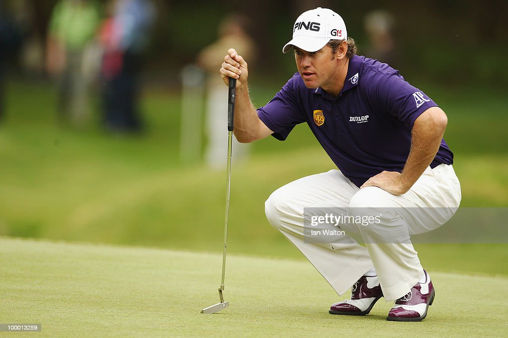 Lee Westwood of England lines up a putt during the first round of the BMW PGA Championship on the West Course at Wentworth on May 20, 2010 in Virginia Water, England.