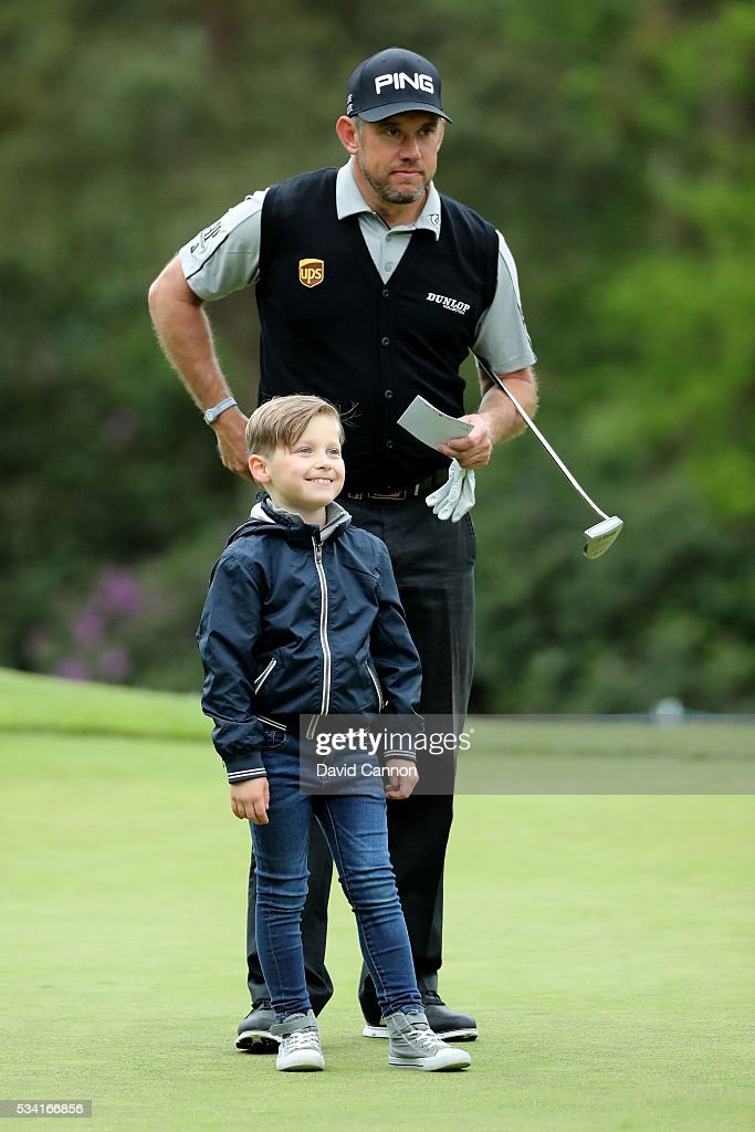 <a gi-track='captionPersonalityLinkClicked' href=/galleries/search?phrase=Lee+Westwood&family=editorial&specificpeople=171611 ng-click='$event.stopPropagation()'>Lee Westwood</a> of England looks on with Jeremy Kyle's son Henry during the Pro-Am prior to the BMW PGA Championship at Wentworth on May 25, 2016 in Virginia Water, England.