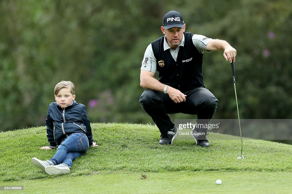 Lee Westwood of England looks on with Jeremy Kyle's son Henry during the Pro-Am prior to the BMW PGA Championship at Wentworth on May 25, 2016 in Virginia Water, England.