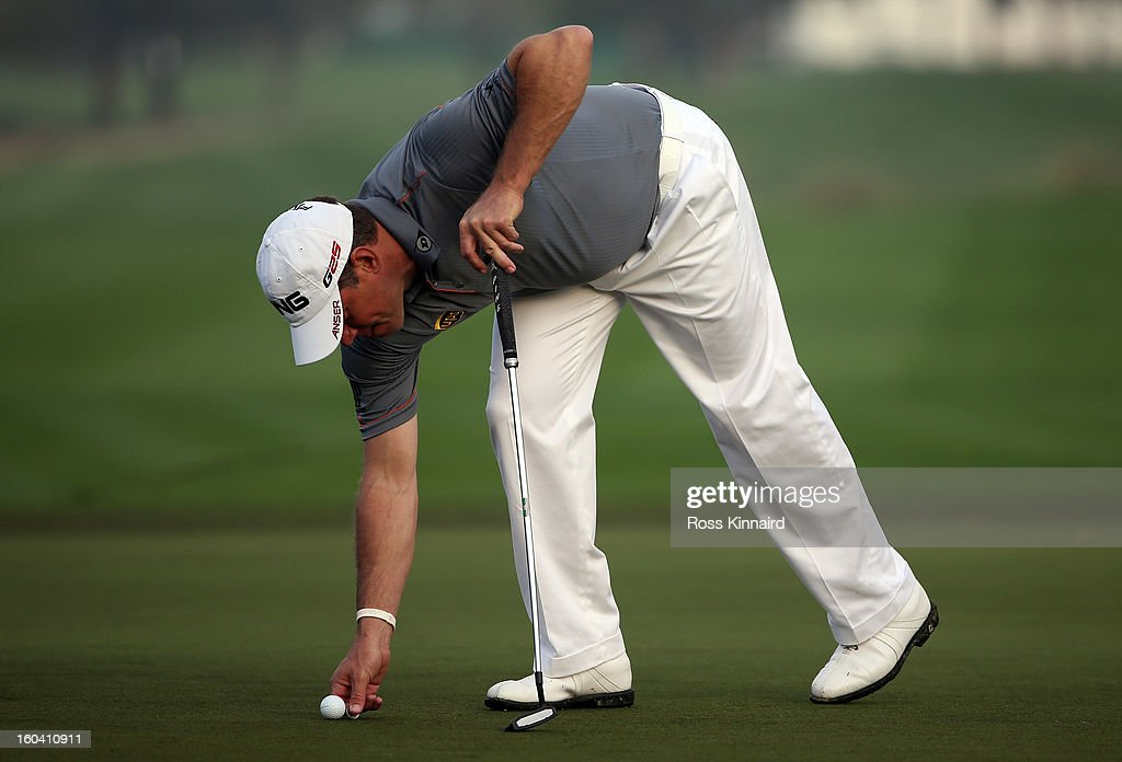 Lee Westwood of England marks his ball during the first round of the Omega Dubai Desert Classic on January 31, 2013 in Dubai, United Arab Emirates.