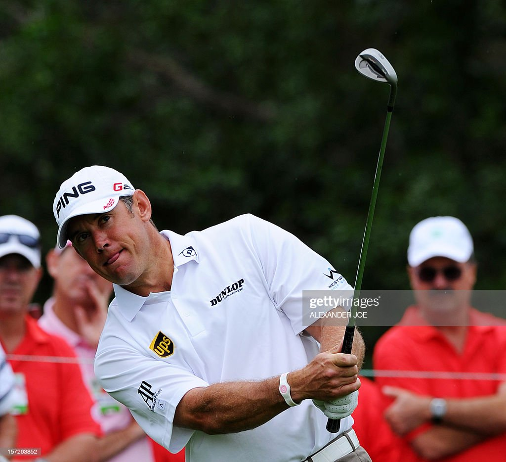 Lee Westwood of England plays a shot, on day 3 of the 4 day 2012 Nedbank Golf Challenge in Sun City on December 1, 2012. AFP PHOTO / Alexander Joe