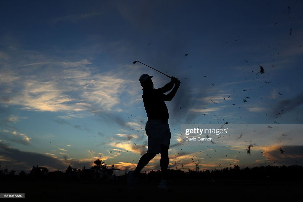 Lee Westwood of England plays a shot on his final hole as the sun sets during the pro-am for the 2017 Abu Dhabi HSBC Golf Championship at Abu Dhabi Golf Club on January 18, 2017 in Abu Dhabi, United Arab Emirates.