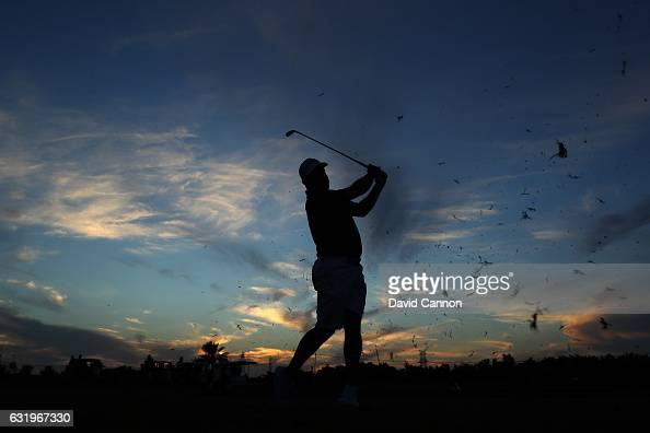 Lee Westwood of England plays a shot on his final hole as the sun sets during the proam for the 2017 Abu Dhabi HSBC Golf Championship at Abu Dhabi...