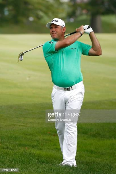 Lee Westwood of England plays a shot on the fourth hole during the second round of the World Golf Championships Bridgestone Invitational at Firestone...