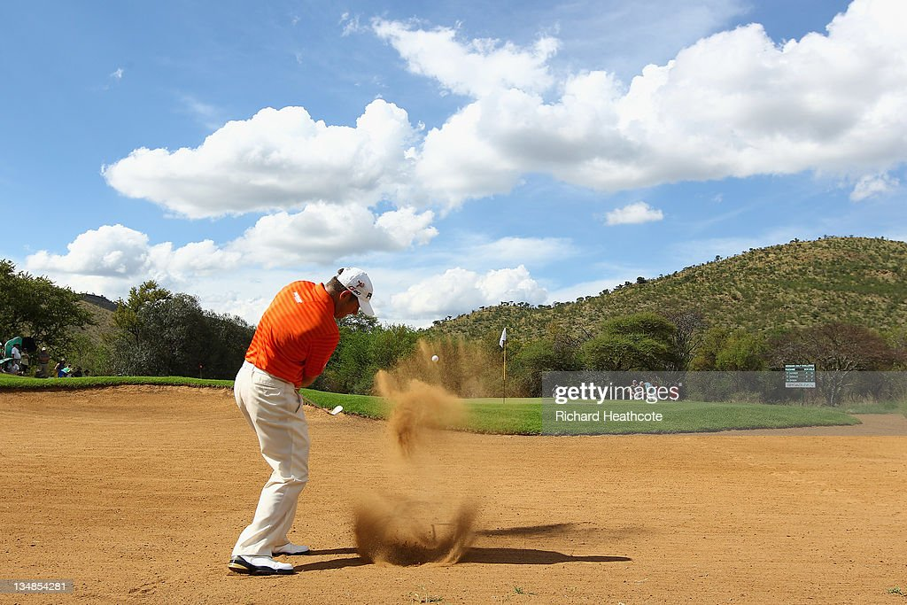 Lee Westwood of England plays from a bunker on the 14th during the final round of the Nedbank Golf Challenge at the Gary Player Country Club on December 4, 2011 in Sun City, South Africa.