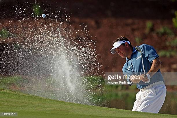 Lee Westwood of England plays from a bunker on the 14th hole during the third round of the Dubai World Championship on the Earth Course Jumeirah Golf...