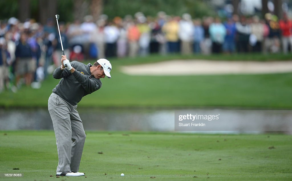 Lee Westwood of England plays his approach shot on the eighth hole during the second round of the Honda Classic on March 1, 2013 in Palm Beach Gardens, Florida.