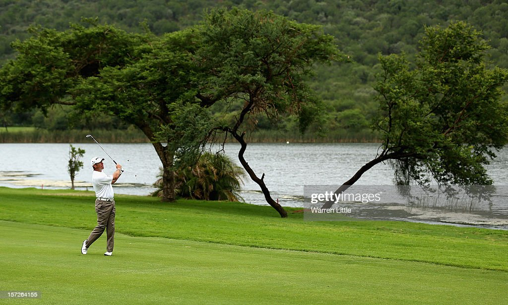 Lee Westwood of England plays his second shot into the 17th green during the third round of the Nedbank Golf Challenge at the Gary Player Country Club on December 1, 2012 in Sun City, South Africa.