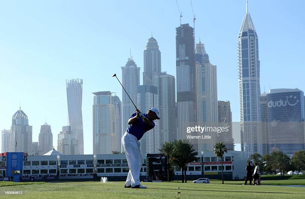 Lee Westwood of England plays his second shot into the 18th green during the final round of the Omega Dubai Desert Classic at Emirates Golf Club on February 3, 2013 in Dubai, United Arab Emirates.