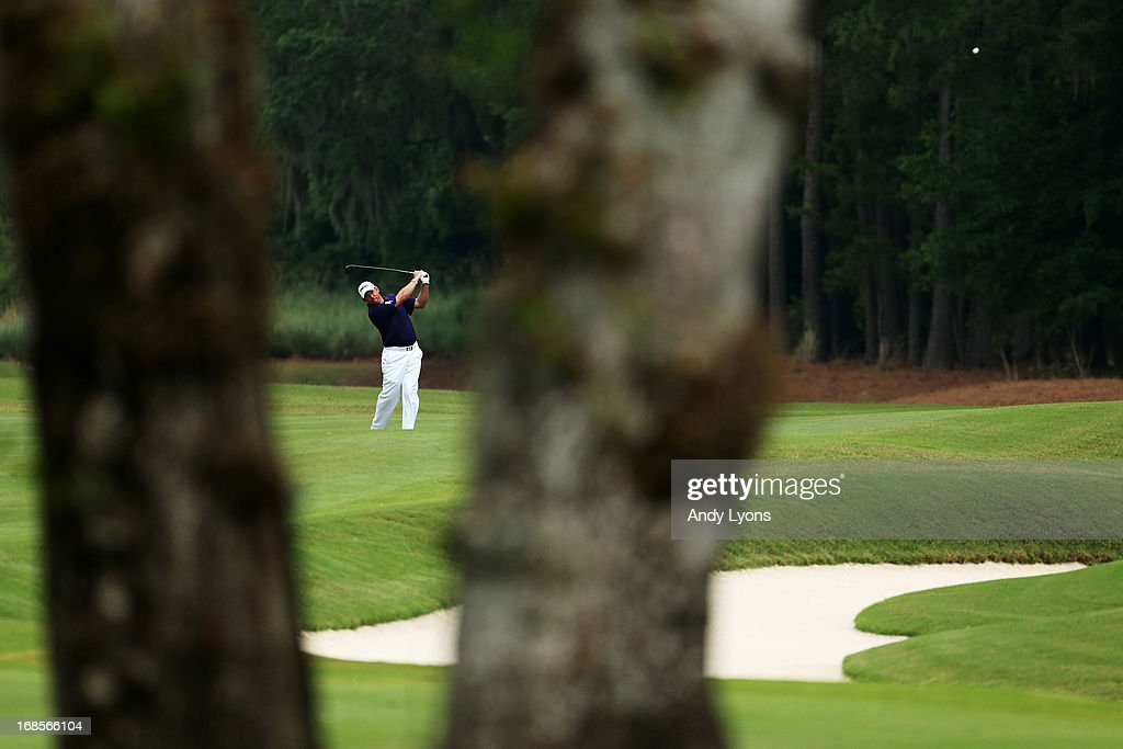 <a gi-track='captionPersonalityLinkClicked' href=/galleries/search?phrase=Lee+Westwood&family=editorial&specificpeople=171611 ng-click='$event.stopPropagation()'>Lee Westwood</a> of England plays his second shot on the 11th hole during round three of THE PLAYERS Championship at THE PLAYERS Stadium course at TPC Sawgrass on May 11, 2013 in Ponte Vedra Beach, Florida.
