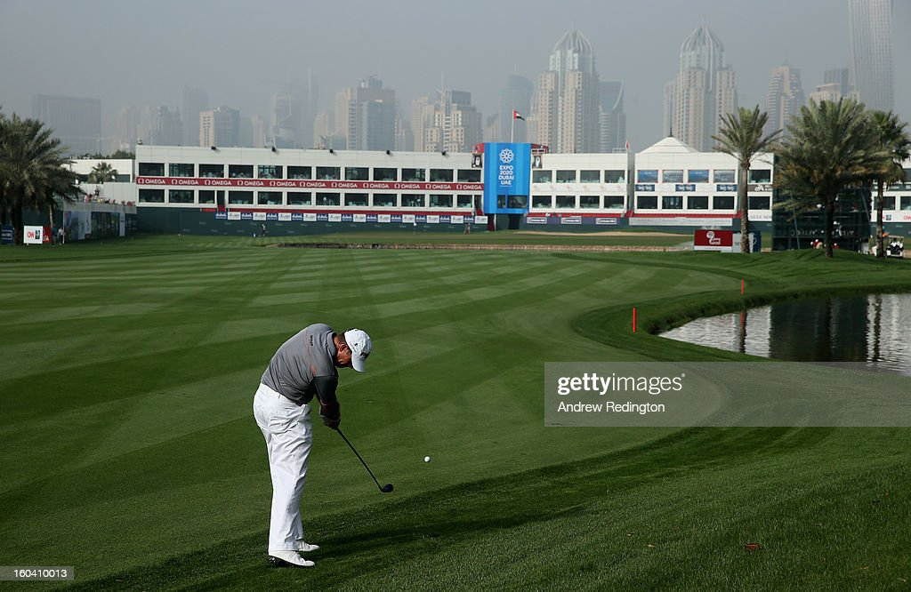 Lee Westwood of England plays his second shot on the 18th hole during the first round of the Omega Dubai Desert Classic at Emirates Golf Club on January 31, 2013 in Dubai, United Arab Emirates.