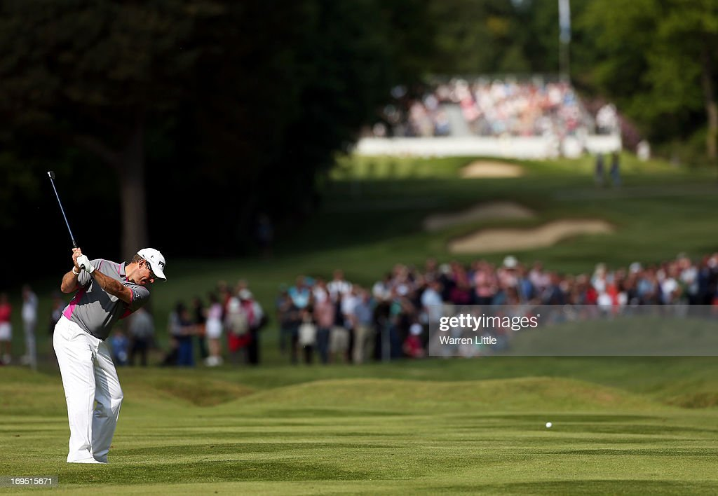 Lee Westwood of England plays his second shot on the fifteenth hole during the final round of the BMW PGA Championship on the West Course at Wentworth on May 26, 2013 in Virginia Water, England.