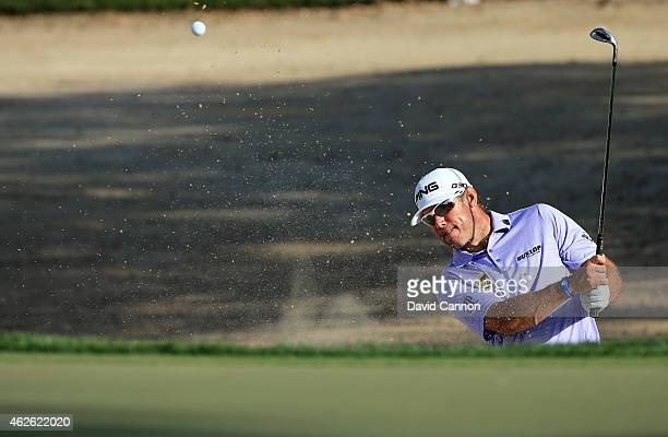 Lee Westwood of England plays his second shot on the par 3 15th hole during the final round of the 2015 Omega Dubai Desert Classic on the Majlis...