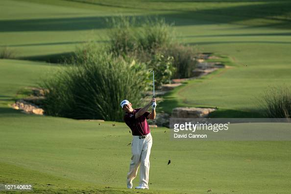 Lee Westwood of England plays his third shot at the 18th hole during the first round of the Dubai World Championship on the Earth Course at Jumeirah...