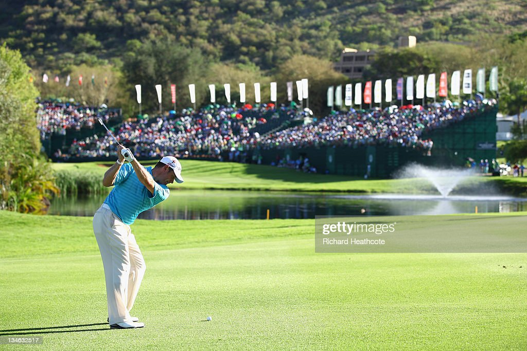 Lee Westwood of England plays into the 18th green during the third round of the Nedbank Golf Challenge at the Gary Player Country Club on December 3...