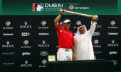 Lee Westwood of England poses alongside His Excellency Matar al Tayer with the Dubai World Championship trophy after winning the Dubai World...