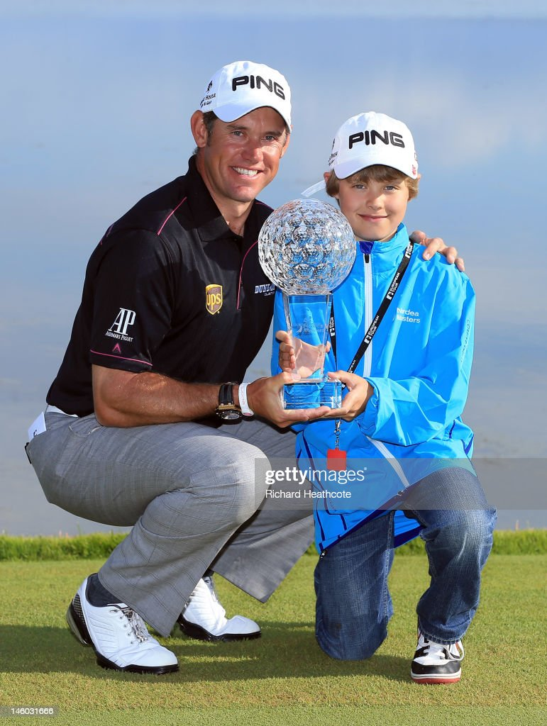 Lee Westwood of England poses with his Son Sam and the trophy after victory in the final round of the Nordea Scandinavian Masters at Bro Hof Slott...