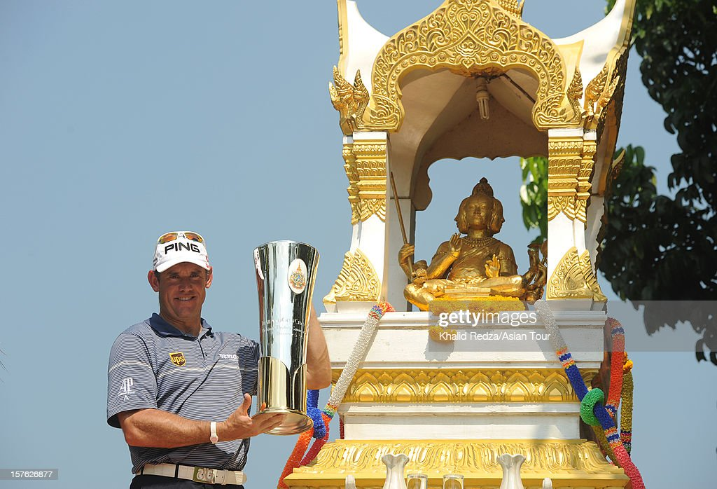 <a gi-track='captionPersonalityLinkClicked' href=/galleries/search?phrase=Lee+Westwood&family=editorial&specificpeople=171611 ng-click='$event.stopPropagation()'>Lee Westwood</a> of England poses with the Thailand Golf Championship trophy beside a shrine ahead of the Thailand Golf Championship at Amata Spring Country Club on December 5, 2012 in Bangkok, Thailand.