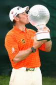 Lee Westwood of England poses with the trophy after victory in the final round of the Nedbank Golf Challenge at the Gary Player Country Club on...