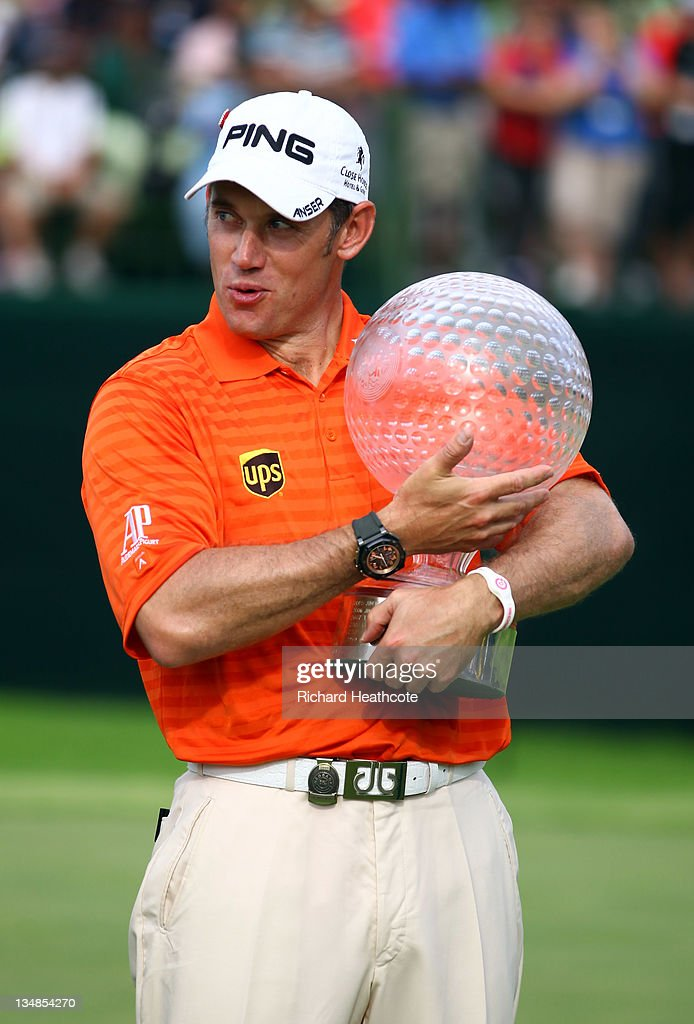 Lee Westwood of England poses with the trophy after victory in the final round of the Nedbank Golf Challenge at the Gary Player Country Club on December 4, 2011 in Sun City, South Africa.
