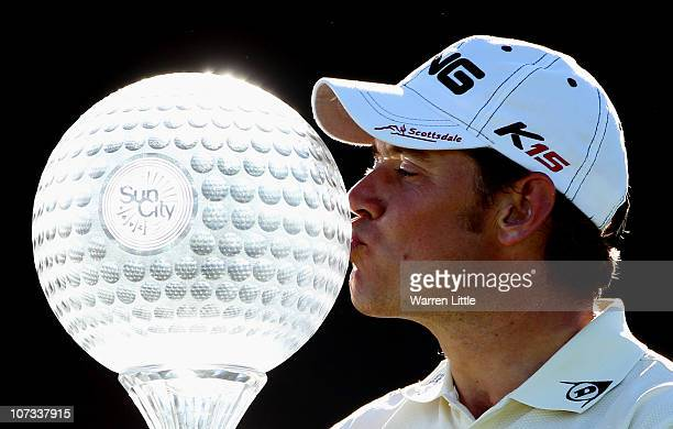 Lee Westwood of England poses with the trophy after winning the 2010 Nedbank Golf Challenge at the Gary Player Country Club Course on December 5 2010...