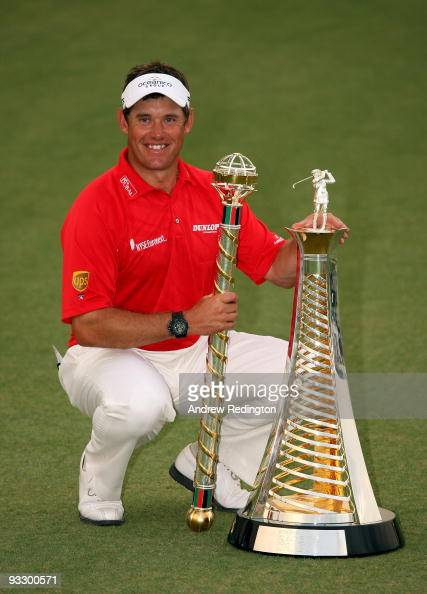 Lee Westwood of England poses with the trophy after winning the Dubai World Championship and the Race To Dubai on the Earth Course Jumeirah Golf...