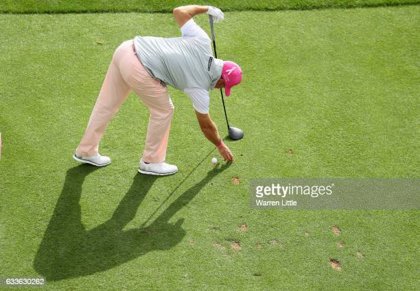 Lee Westwood of England prepares to tee off on the 17th hole during the second round of the Omega Dubai Desert Classic on the Majils Course at...