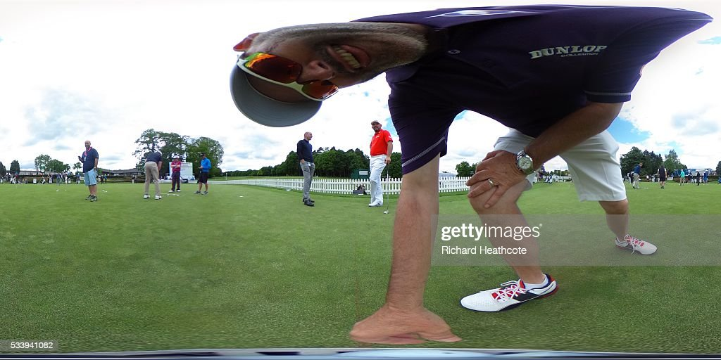 Lee Westwood of England putting with his caddy Billy Foster during a practice round for the BMW PGA Championship at Wentworth on May 24, 2016 in Virginia Water, England.
