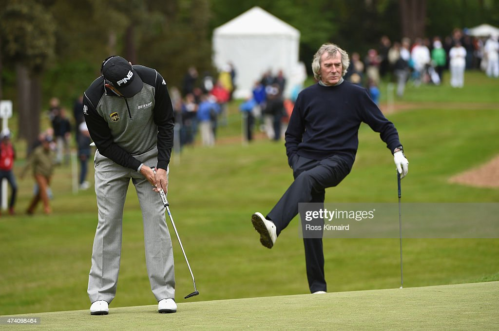 <a gi-track='captionPersonalityLinkClicked' href=/galleries/search?phrase=Lee+Westwood&family=editorial&specificpeople=171611 ng-click='$event.stopPropagation()'>Lee Westwood</a> of England putts as <a gi-track='captionPersonalityLinkClicked' href=/galleries/search?phrase=Pat+Jennings&family=editorial&specificpeople=225090 ng-click='$event.stopPropagation()'>Pat Jennings</a> reacts during the Pro-Am ahead of the BMW PGA Championship at Wentworth on May 20, 2015 in Virginia Water, England.