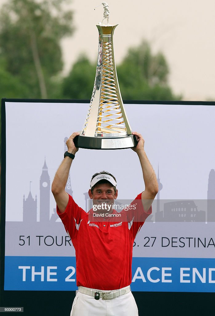 Lee Westwood of England raises the Race to Dubai Trophy after his victory in the final round of the Dubai World Championship on the Earth Course...