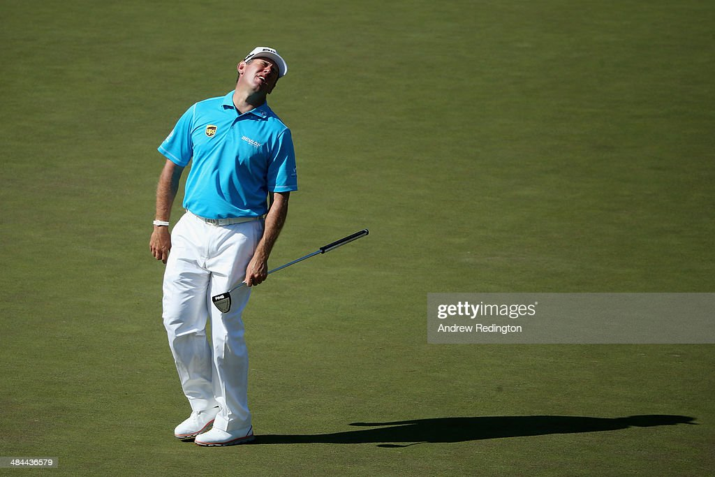 Lee Westwood of England reacts to a missed eagle putt on the 15th green during the third round of the 2014 Masters Tournament at Augusta National...