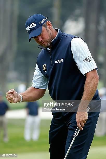 Lee Westwood of England reacts to a putt on the 17th hole green during round three of the World Golf Championships Cadillac Match Play at TPC Harding...