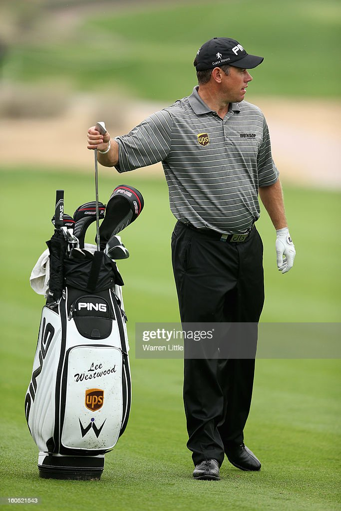 <a gi-track='captionPersonalityLinkClicked' href=/galleries/search?phrase=Lee+Westwood&family=editorial&specificpeople=171611 ng-click='$event.stopPropagation()'>Lee Westwood</a> of England selects a club during the third round of the Omega Dubai Desert Classic at Emirates Golf Club on February 2, 2013 in Dubai, United Arab Emirates.
