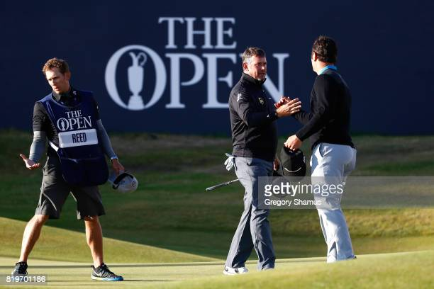 Lee Westwood of England shakes hands with Jon Rahm of Spain on the 18th hole during the first round of the 146th Open Championship at Royal Birkdale...