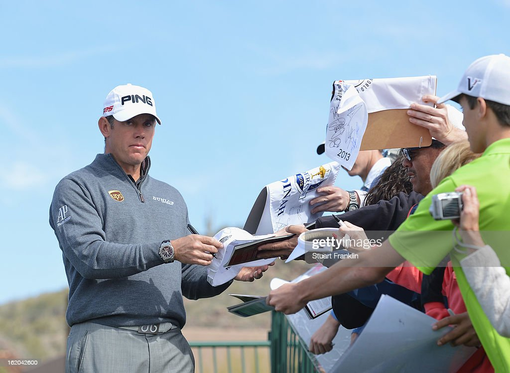 Lee Westwood of England signs an autograph during practice prior to the start of the World Golf Championships-Accenture Match Play Championship at the Ritz-Carlton Golf Club on February 18, 2013 in Marana, Arizona.