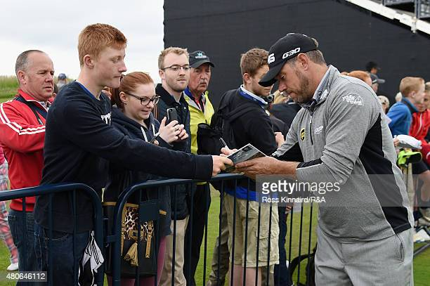Lee Westwood of England signs his autograph for a fan ahead of the 144th Open Championship at The Old Course on July 14 2015 in St Andrews Scotland