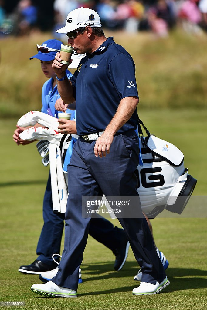 Lee Westwood of England sips his beverage as he walks up a fairway during a practice round prior to the start of The 143rd Open Championship at Royal Liverpool on July 15, 2014 in Hoylake, England.