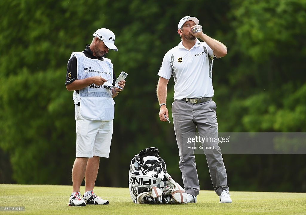 Lee Westwood of England takes a tablet during day one of the BMW PGA Championship at Wentworth on May 26, 2016 in Virginia Water, England.
