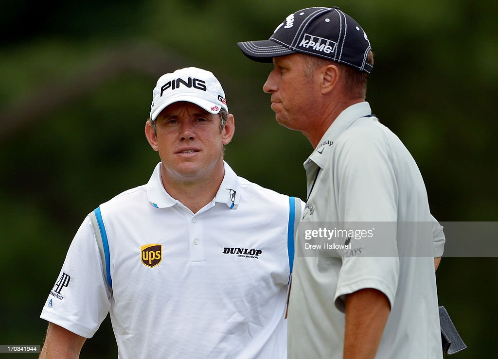 <a gi-track='captionPersonalityLinkClicked' href=/galleries/search?phrase=Lee+Westwood&family=editorial&specificpeople=171611 ng-click='$event.stopPropagation()'>Lee Westwood</a> of England talk with caddie Jim 'Bones' Mackay during a practice round prior to the start of the 113th U.S. Open at Merion Golf Club on June 11, 2013 in Ardmore, Pennsylvania.