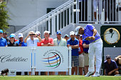 Lee Westwood of England tees off on the tenth hole during the first round of the World Golf ChampionshipsCadillac Championship at Trump National...