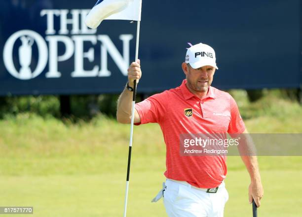 Lee Westwood of England tends a pin flag during a practice round prior to the 146th Open Championship at Royal Birkdale on July 18 2017 in Southport...