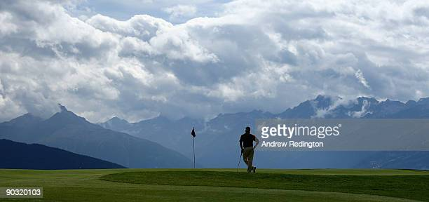 Lee Westwood of England waits to play on the seventh hole during the first round of The Omega European Masters at CransSurSierre Golf Club on...