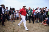 Lee Westwood of England walks back to the fairway after he hits out of the rough on the 3rd hole during the final round of the 142nd Open...