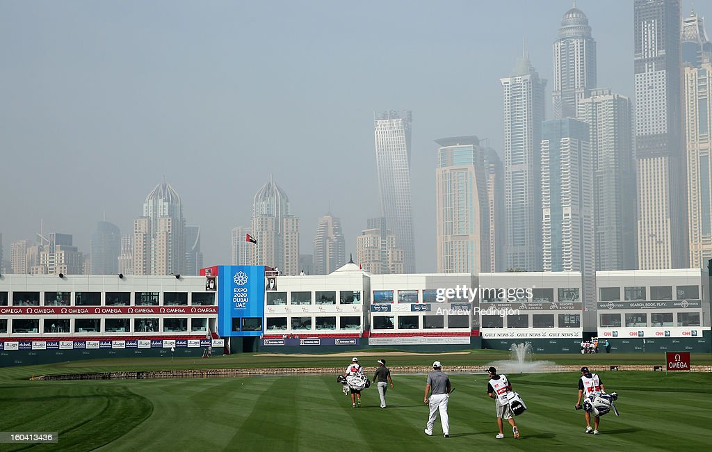 Lee Westwood of England walks with his caddie Mike Kerr on the 18th hole during the first round of the Omega Dubai Desert Classic at Emirates Golf Club on January 31, 2013 in Dubai, United Arab Emirates.