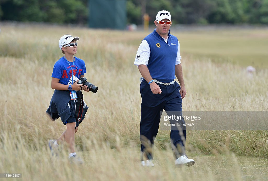<a gi-track='captionPersonalityLinkClicked' href=/galleries/search?phrase=Lee+Westwood&family=editorial&specificpeople=171611 ng-click='$event.stopPropagation()'>Lee Westwood</a> of England walks with his son Samuel ahead of the 142nd Open Championship at Muirfield on July 16, 2013 in Gullane, Scotland.