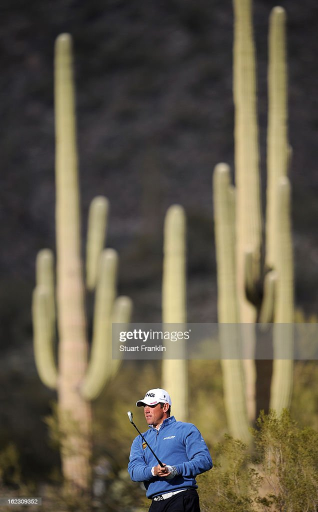 Lee Westwood of England watches his shot on the first hole, the nineteenth hole of his match, during the first round of the World Golf Championships - Accenture Match Play at the Golf Club at Dove Mountain on February 21, 2013 in Marana, Arizona. Round one play was suspended on February 20 due to inclimate weather and is scheduled to be continued today.