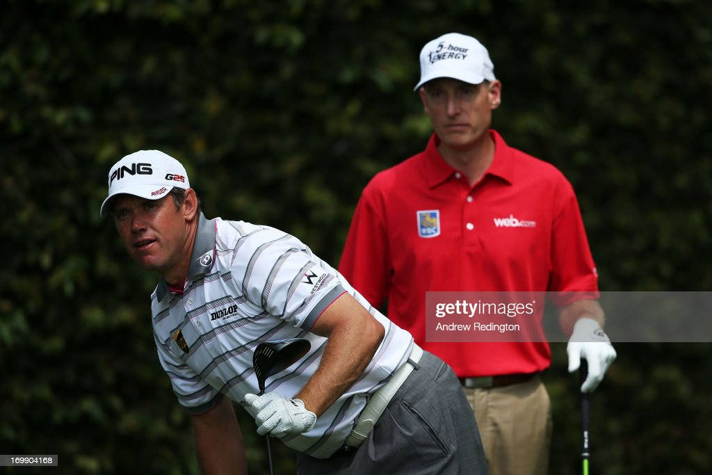 Lee Westwood of England watches his tee shot as Jim Furyk of the United States looks on during the second round of the 2013 Masters Tournament at Augusta National Golf Club on April 12, 2013 in Augusta, Georgia.