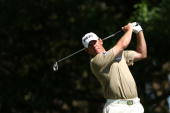 Lee Westwood of England watches his tee shot on the fourth hole during the third round of the 2010 Masters Tournament at Augusta National Golf Club...